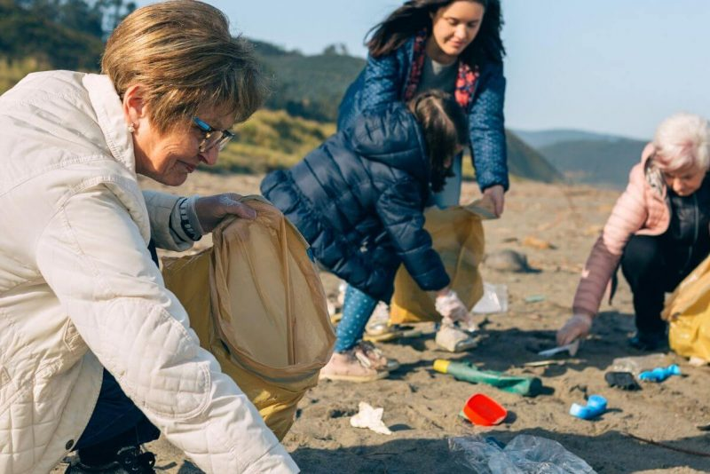Family litter pick on beach