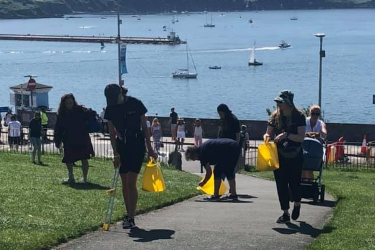 litter pickers on the waterfront