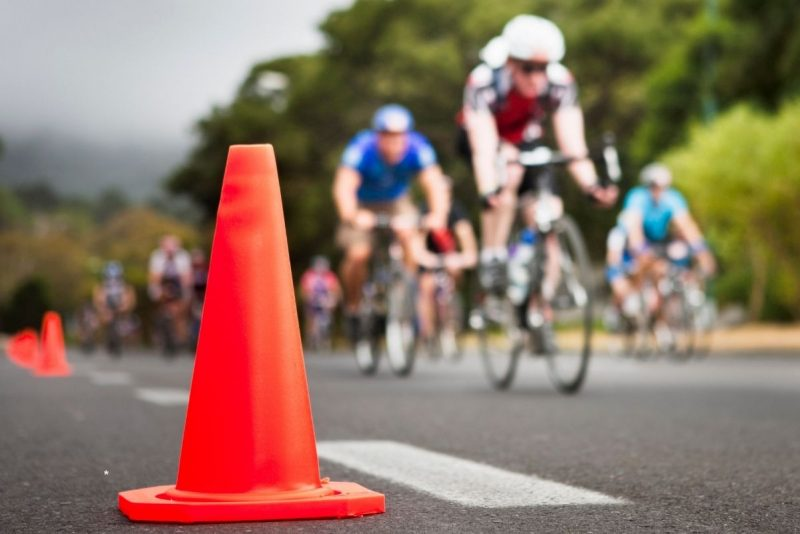 Plastic cone with cyclists racing in background