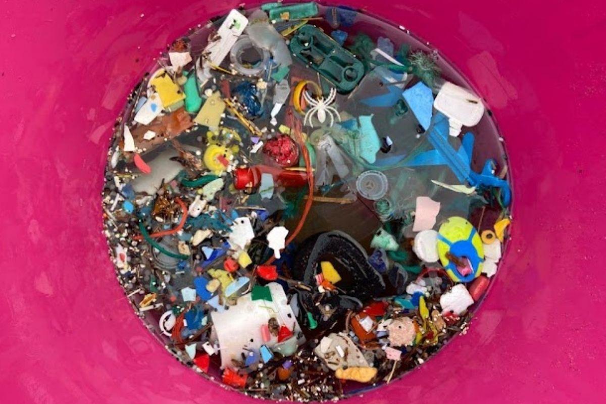 mixed plastics in pink bucket